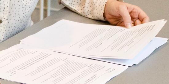 woman holding paperwork